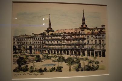 Anónimo. La Plaza Mayor. 1878. Papel fotográfico iluminado (estampa fotografiada por Jesús Evaristo Casariego). Museo de Historia de Madrid. In 18.882.